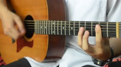 Acoustic guitar in musician hands Stock Footage
