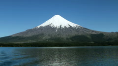 View of a volcano from a lake in Chile Stock Footage