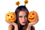 Woman with handband holding two pumpkins Stock Photos