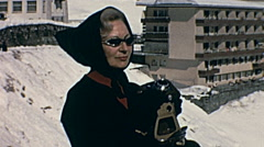 St. Moritz, Switzerland 1967: woman taking a picture Stock Footage