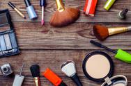 Various make-up products laid on wooden table. Copy space Stock Photos