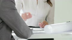 An attractive young businesswoman are having a conversation with her collegue in Stock Footage