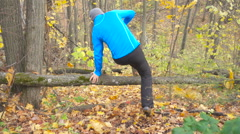 Man  Jogging  cross country And Jumping Over Obstacle running in forest. Trai Stock Footage
