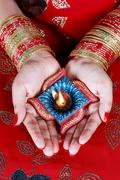 Indian Festival Diwali Diya Lamp in Female Hand Stock Photos