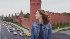 Tourist smiling  in front of famous Russian tourist  attraction in Moscow. Stock Footage