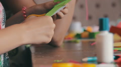 Children Make Crafts Out of Paper at the Table, HandMade Stock Footage