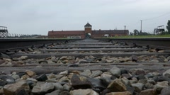 Crane up railroad, Birkenau gate train station in Auschwitz concentration camp Stock Footage