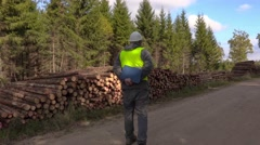 Stressful lumberjack on the forest road near logs Stock Footage