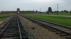 Railroad Birkenau gate train station, ruins of Buildings of Auschwitz camp Stock Footage