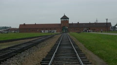Railroad Birkenau gate train station, ruins of Buildings Auschwitz camp Stock Footage