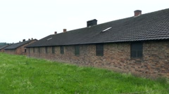 A right to left pan across Buildings of Auschwitz concentration camp in Poland Stock Footage