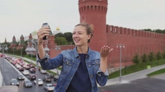 Girl chating on facetime on the phone in front of Kremlin. Russia summer 2016 Stock Footage