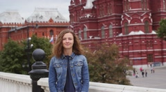 Tourist on travel smiling in fron of famous Russian tourist destination Stock Footage