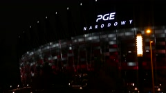 Left to right pan of the The PGE Narodowy or National Stadium Warsaw at night Stock Footage