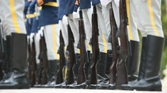Soldiers in rifle rest position during a military ceremony Stock Footage