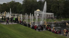 Group of tourists visiting the Grand Palace in Peterhof St.Petersburg, Russia Stock Footage