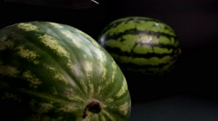 Watermelon with knife and black background Stock Footage