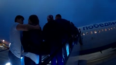 Passengers boarding on the aircraft of low cost airline company Ryanair Stock Footage