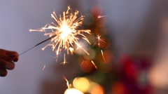 Woman's Hand Hold Show Sparklers, Bengal Fire, Lights Bokeh Background From Stock Footage