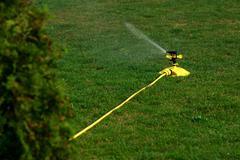 Sprinkler spraying water Kuvituskuvat