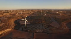 Very large wind turbines array at sunset Stock Footage