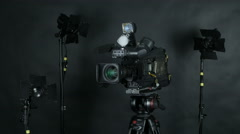 Professional broadcast camera at unrecognizable tv news studio. Isolated on Stock Footage
