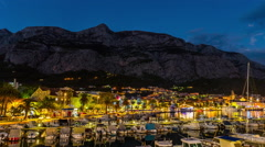 Time lapse of Makarska harbour and its old town. Stock Footage