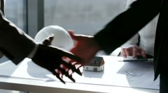 Close up Two business partner shake hands when meeting in front of large Stock Footage