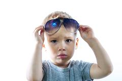 Portrait of charming kid with sunglasses in his head Stock Photos