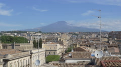 Rooftops with Mount Etna in the background. Catania, Sicily, Italy. Stock Footage