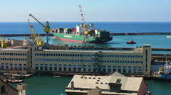 Towing a ship in the port of Genoa Stock Footage