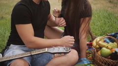 Happy couple relaxing on the picnic at the park Stock Footage