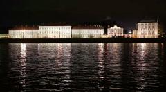 Night view of the University embankment of St. Petersburg through the Neva River Stock Footage