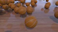 Multiple basketball balls rolling and bouncing on wooden floor. 4K ProRes clip Stock Footage