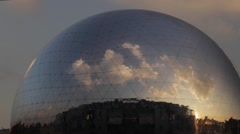 Globalisation - zoom in on clouds reflected in giant mirror sphere Stock Footage