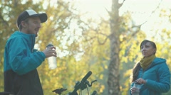 Bottle for water. Guy and girl drink clean water after a workout Stock Footage