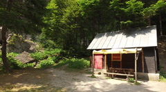 Hikers shelter hut or log cabin in the mountain woods Stock Footage
