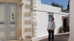 Man explores scenic street in Chora on the island of Patmos Stock Footage