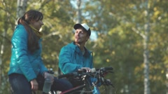 Young man and pretty young woman on a date in the autumn forest Stock Footage