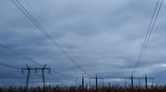 Timelapse video running clouds over high voltage power line Stock Footage