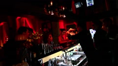 RUSSIA, MOSCOW, 31.10.2015: Bartender in scary Halloween makeup mix cocktails Stock Footage