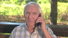 Senior man with mobile phone. Stock Footage