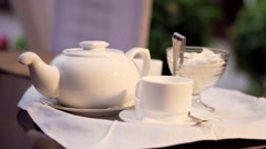 A teacup, a teapot and a sugar bowl Stock Footage