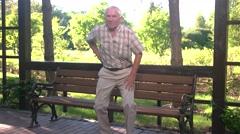 Elderly male has backache. Stock Footage