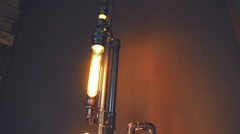Designer incandescent bulbs on a metal pipe Stock Footage
