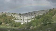 4K Rainbow Over Malham Cove Lime Stone Cliff Woodland Trees Stock Footage