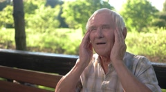 Old man holding his head. Stock Footage