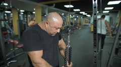 Close-up of a muscular man lifting weights Stock Footage