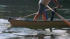Man rowing in Valesana style with two oars on Ticino River, Italy Stock Footage