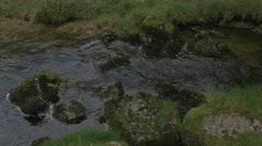 4K Malham Beck Stream by Malham Cove Lime Stone Cliff Woodland Trees Stock Footage